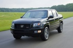 2013 Honda Ridgeline in Crystal Black Pearl - Driving Front Left View